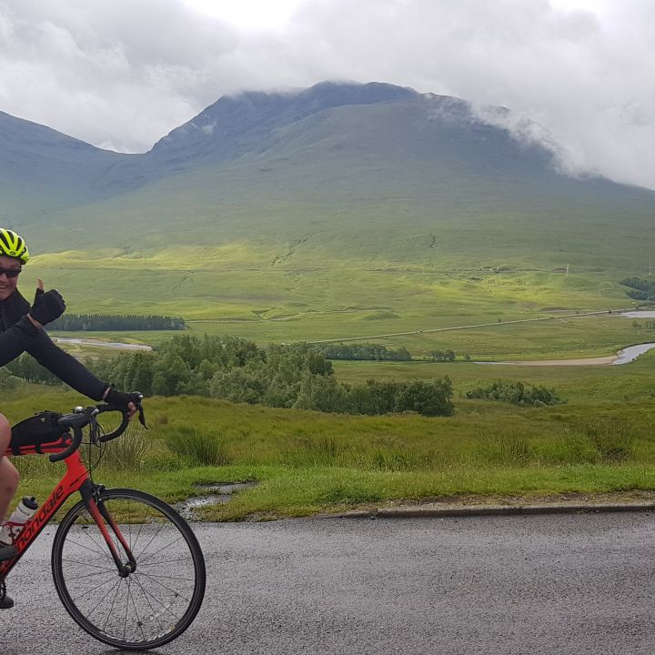 cyclist with Loch in the background