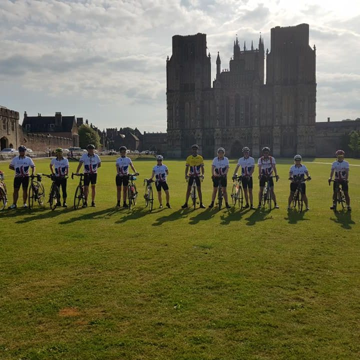 cyclists outside Wells Cathedral