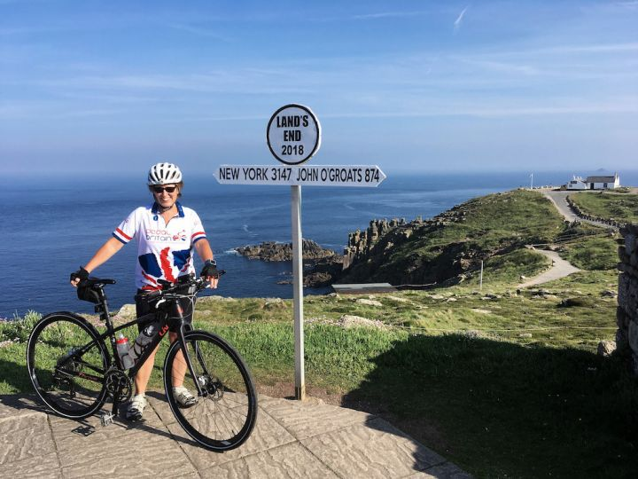 picture of lady with bike at lands end